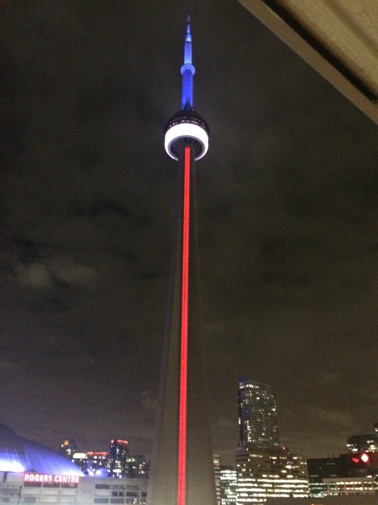 Toronto's CN Tower now lit in red, white and blue.  Photo by @trueblue8209 #ParisAttack https://t.co/ZimudZanlY