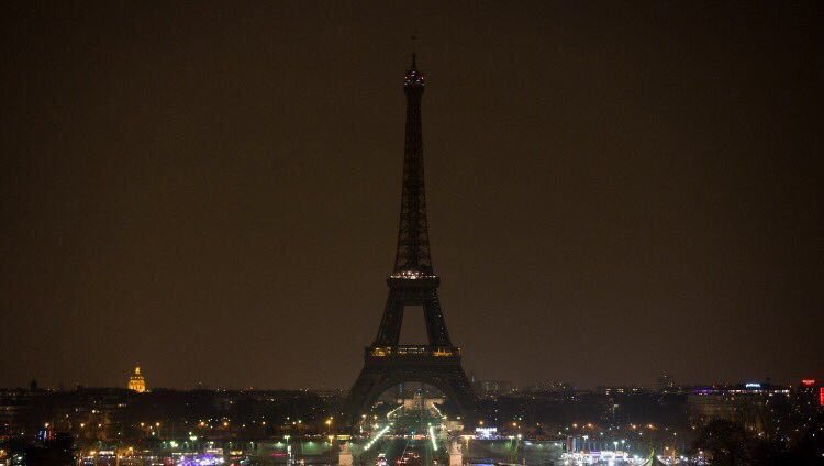 The Eiffel Tower went dark tonight.  This picture communicates so much.  May God's light and mercy shine upon us all https://t.co/aSWZXo4VFt