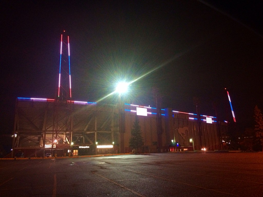 McMahon Stadium lot up in red white & blue