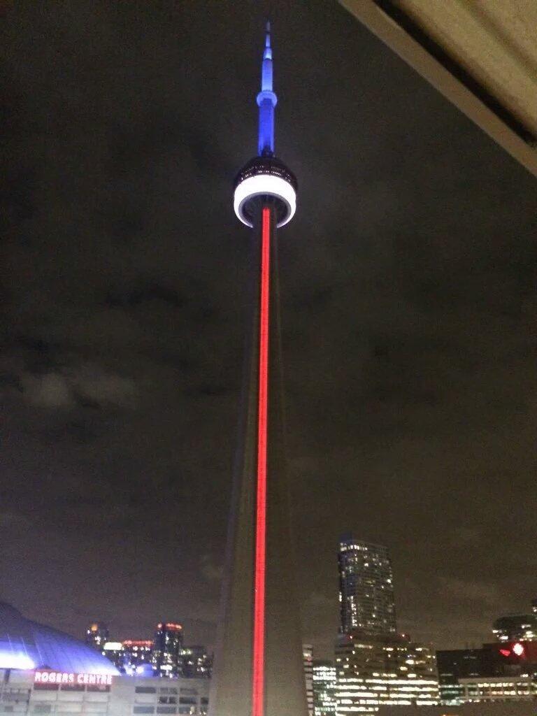 #Toronto landmarks lit up in blue, white & red tonight. Nathan Phillips Square vigil for #Paris @ 2pm. #ParisAttacks https://t.co/xYTSdMoBCs