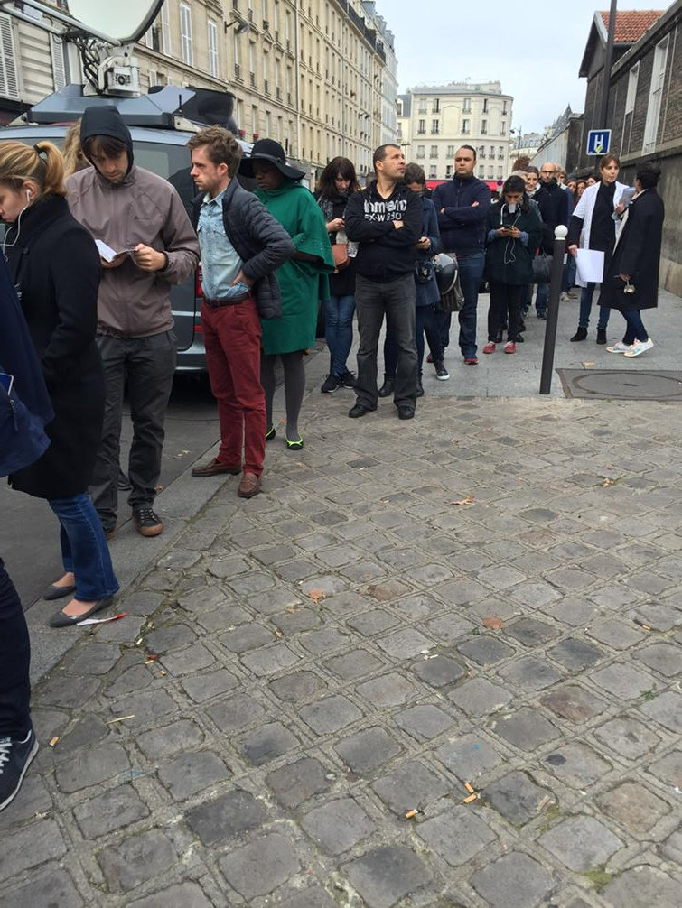 Parisians stand in line to donate blood. 99 people still critical after #parisattacks