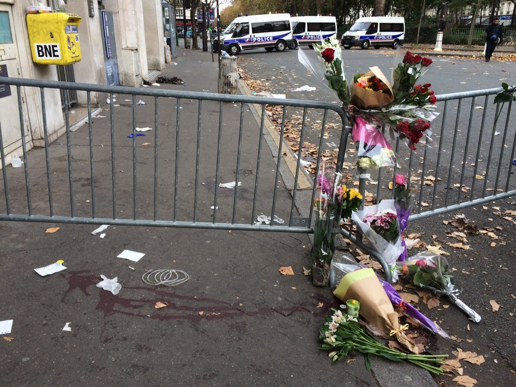 Blood and flowers on the pavement outside Bataclan theatre in Paris. They're still bringing out the bodies https://t.co/4wWkhREzfG