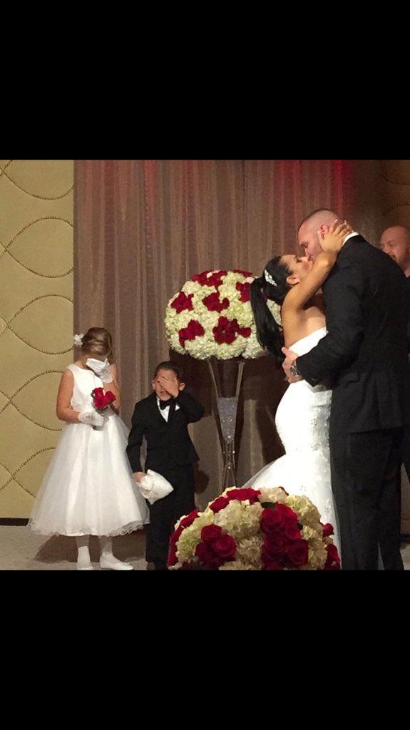 Randy Orton kissing his bride Kim Marie