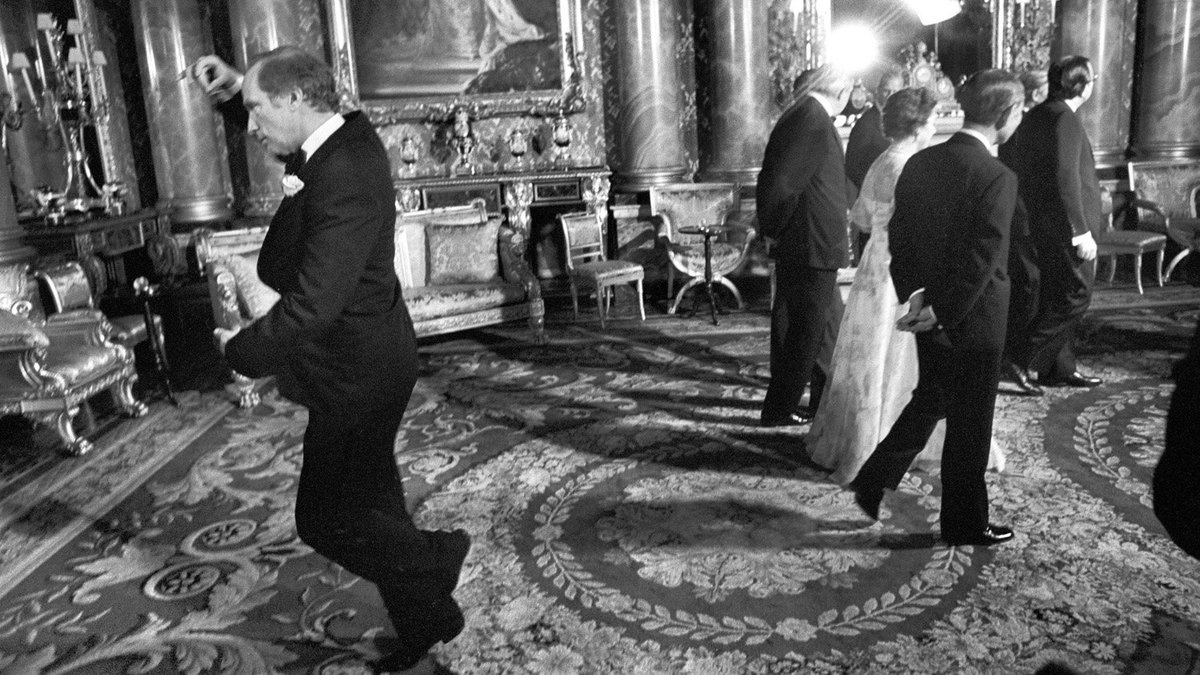PM Pierre Trudeau doing a pirouette behind the Queen