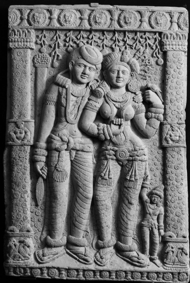 A rare instance of shu~Nga age mystery goddess with consort; note conservativeness in India footware for 2200 yrs