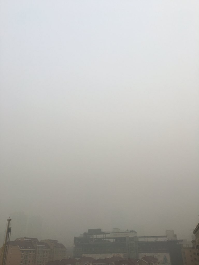 So this a picture of Beijings tallest building. Just a tad polluted today. https://t.co/UgTSAVul3c