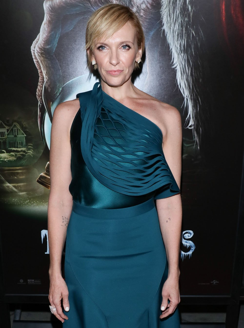 We love the hypnotic emerald green hue of Toni Collette's @_DION_LEE_ look #Krampus https://t.co/EjFwswB840 https://t.co/WKCbFBb7o8