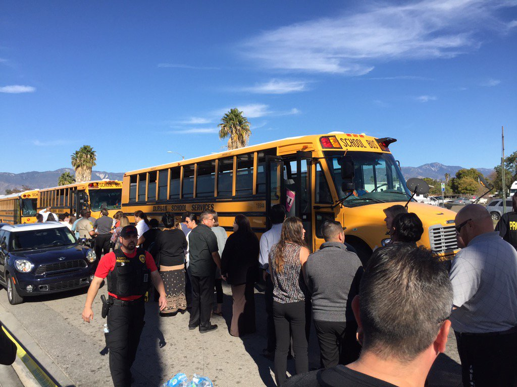 Buses line up to take San Bernardino shooting witnesses to a location to give statements. (Sarah Parvini / Los Angeles times)