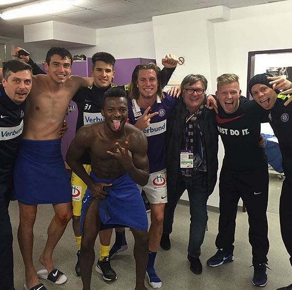 Shikov and some of his teammates celebrate the win