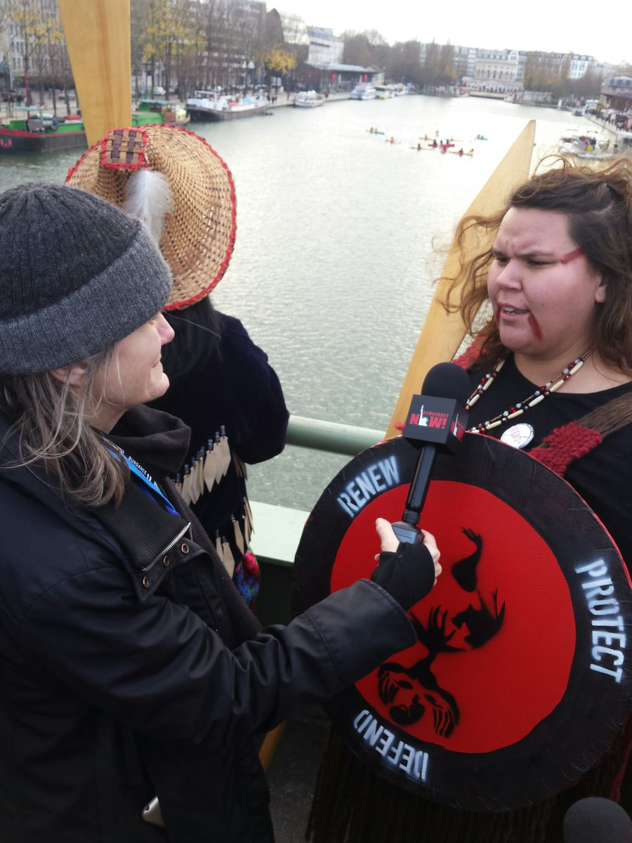 "PHOTO: Amy interviews a young indigenous activist @ ""Canoe of Life"" climate flotilla protest #COP21 #behindthescenes"