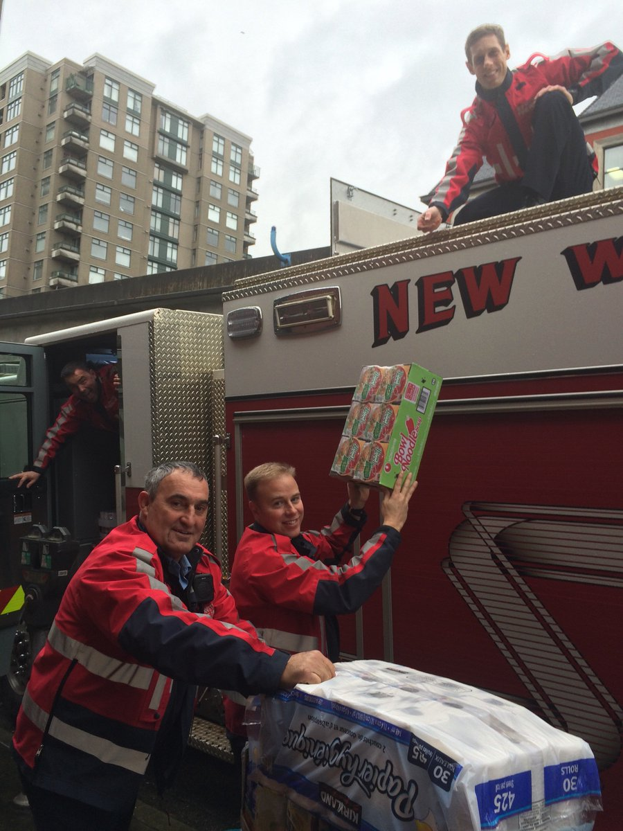 Love this! @New_Westminster Fire Rescue unloading donations at UGM #NewWest! Thanks to @gffg for the food drive! https://t.co/uHFmYIJgrV