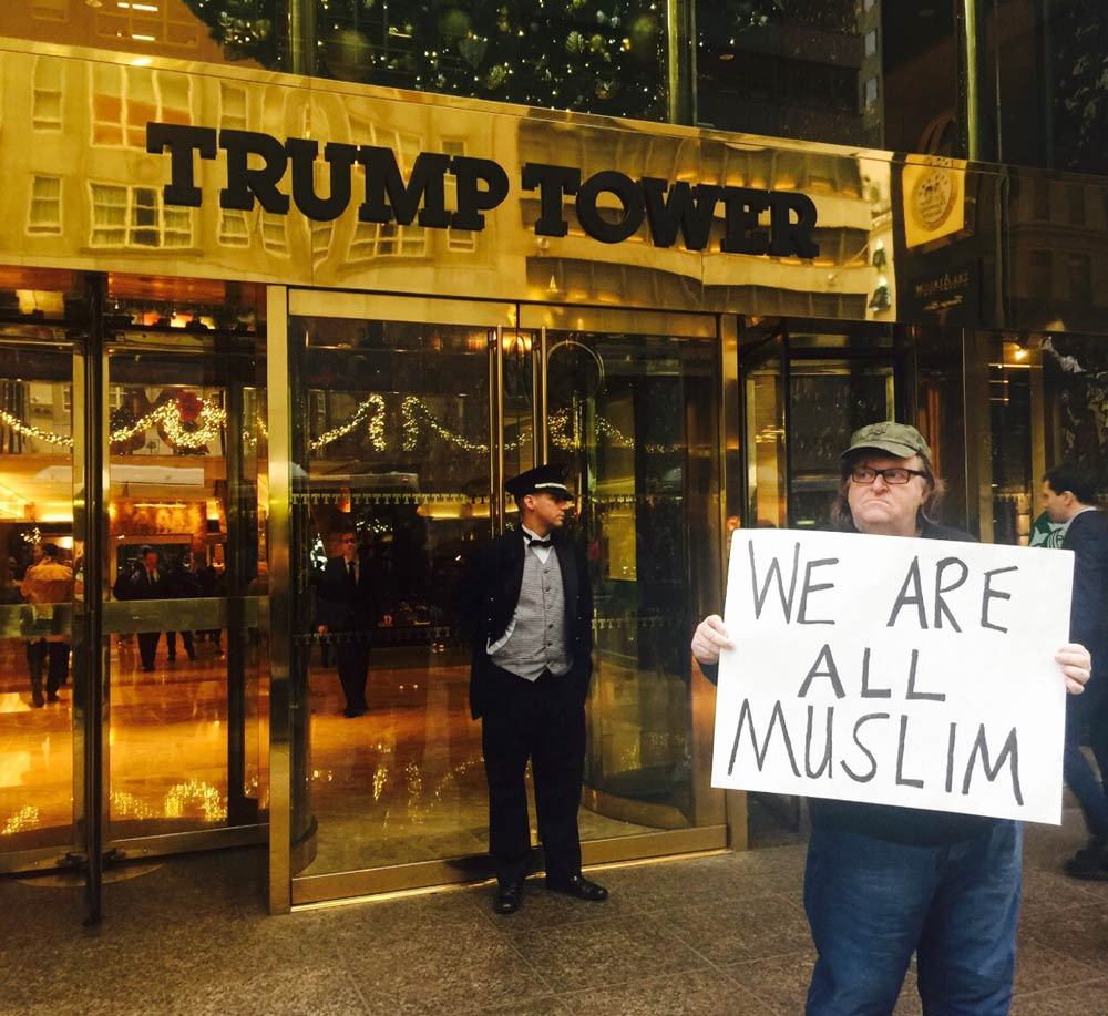 Picture of Michael Moore in from of Trump Tower