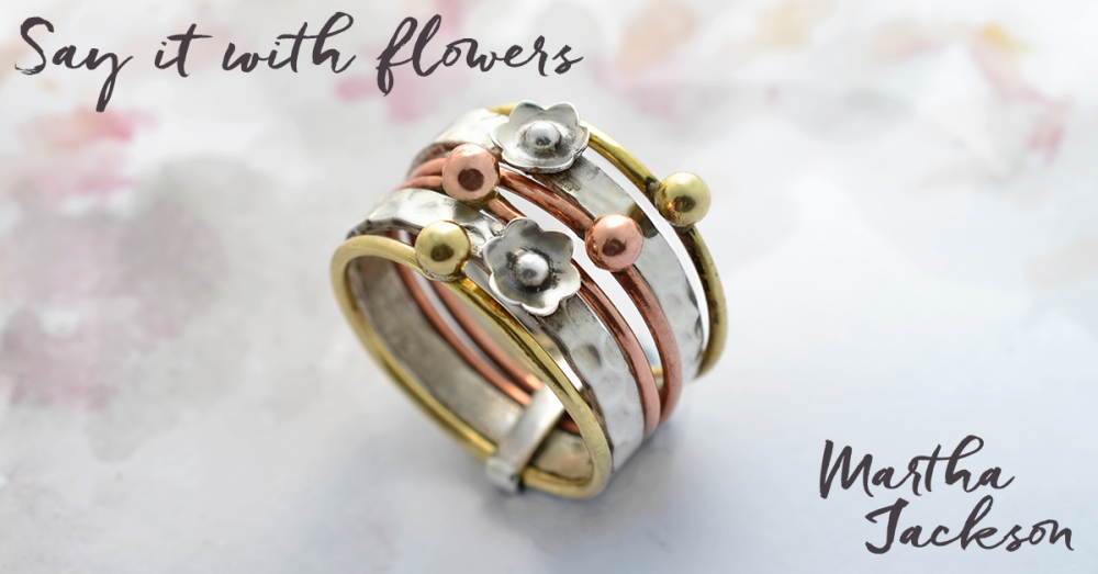 7c56705d3b7227 Our gorgeous silver spinning ring. Buy one here:  http://www.marthajackson.co.uk/products/sterling-silver -mixed-metal-floral-stacking-ring … #jewelry ...