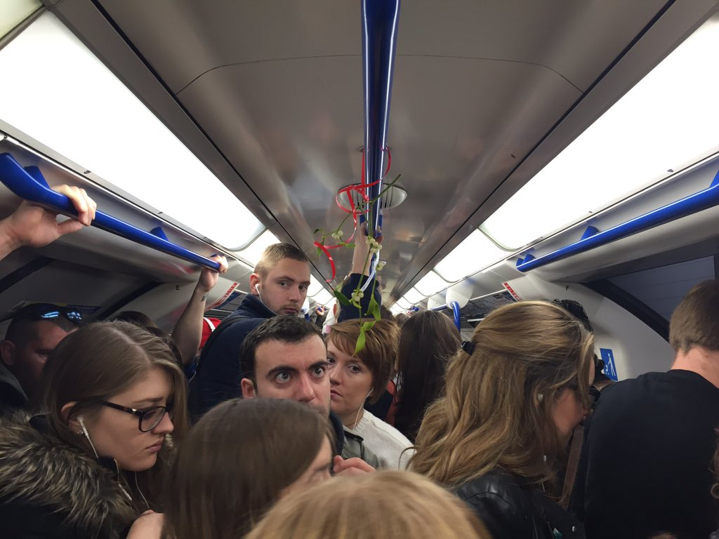 Someone has decided to put mistletoe on the London Underground