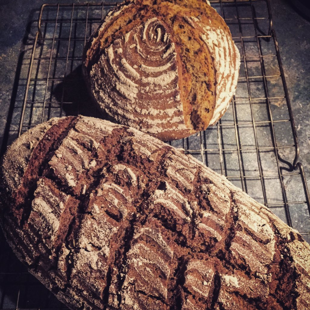 Meanwhile in my kitchen... Dark #ryesourdough and light #wheatsourdough. My home smells like  #homemade #sourdough<br>http://pic.twitter.com/U6msSddYXM