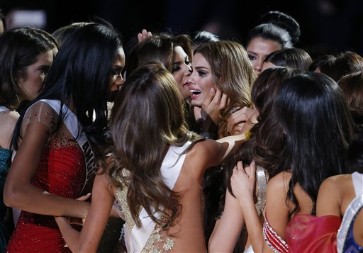 Pic by @locherphoto: contestants comfort Miss Colombia after crown taken. #MissUniverse2015 https://t.co/voDq2Sv45c https://t.co/qzY4AxDLZ3