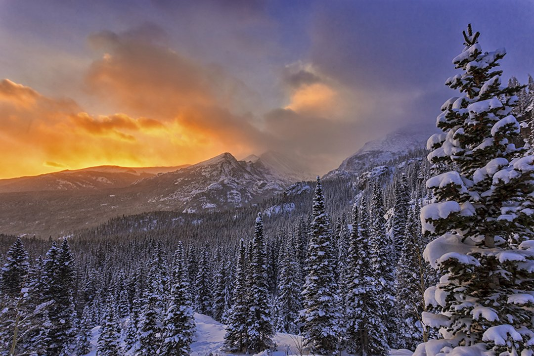 Caption from U.S. Department of Interior on Twitter: #Sunrise over the snowy mountains @rockynps is amazing. Photo by Eric Schuette #Colorado