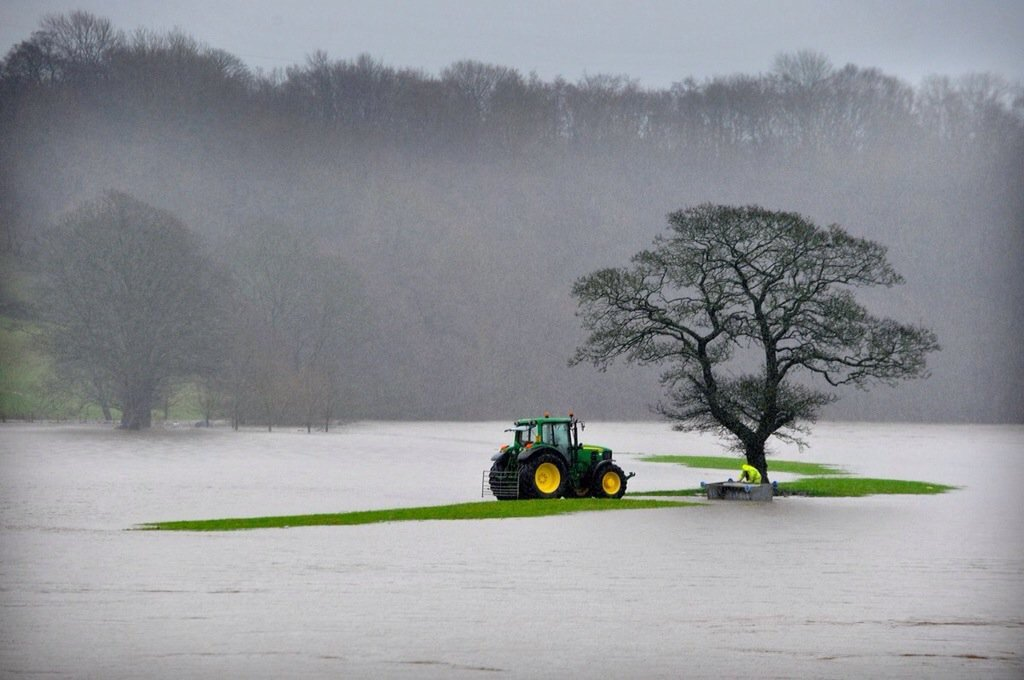 Amazing picture by @roblocksnapper of a farmer rescuing flooded livestock. #floods #compassion @Bremont @JohnDeere https://t.co/BCB5utTcoc