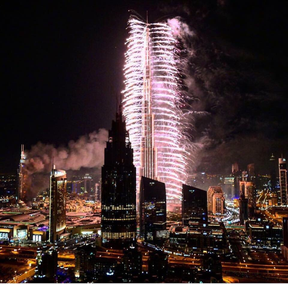 Crazy photo from #DubaiFire (on the left). Burj Khalifa fireworks went on as planned. https://t.co/vRlBwGxerx
