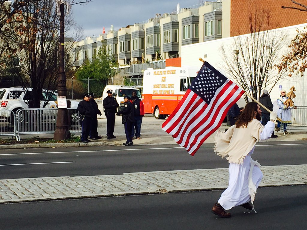 And there goes @phillyjesus, running along Broad Street with an American flag. #MummersParade https://t.co/OK4eBuhgQn