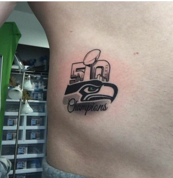 I bet this Seahawks fan regrets this tattoo... #Seattle #SEAvsCAR #SeattleSeahawks https://t.co/VAuF8NEwTC