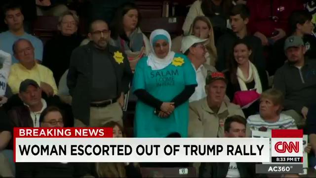 """Muslim woman wearing a Hijab escorted out of @realDonaldTrump rally. Shirt says """"Salam I come in peace"""" https://t.co/ku53dIrs7x"""