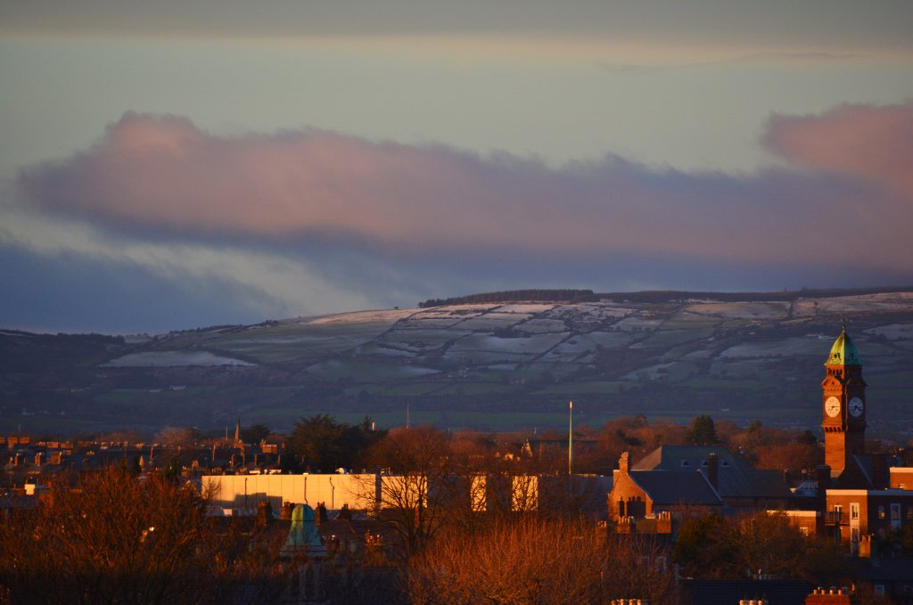 #Sunrise reflected on #snow covered #Wicklow Mountains & #Rathmines clock tower, #Dublin, 10.01.2015. #Sneachta (4) https://t.co/0EbMkuZJom