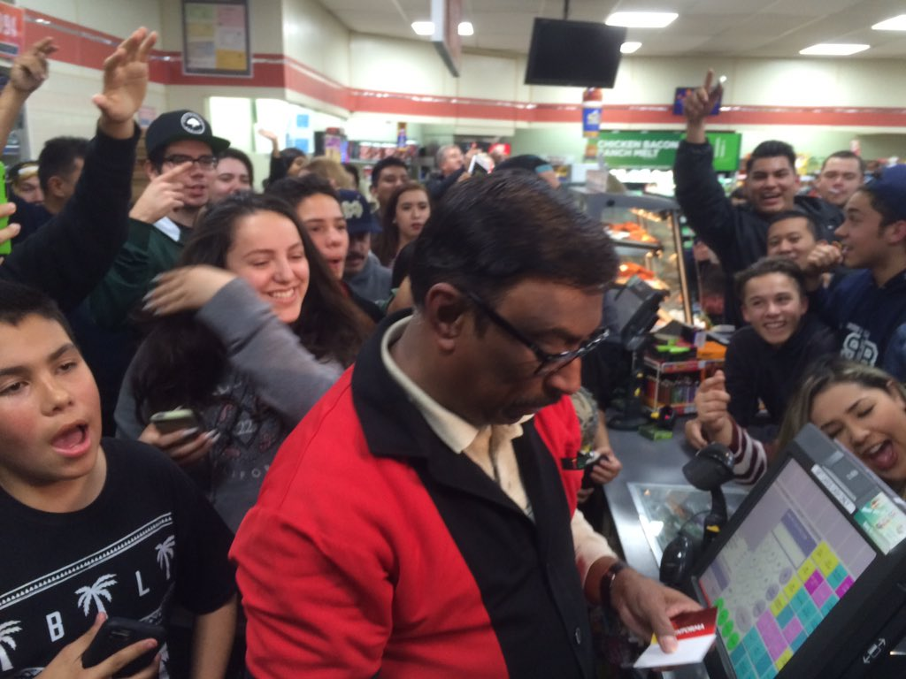 Huge crowd celebrating around assistant manager in winning 7-11 #Powerball