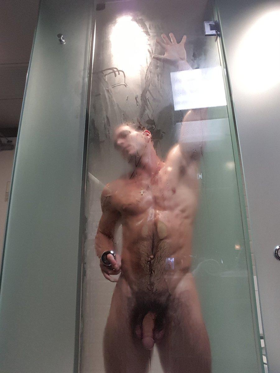 Nude hottie with a big cock showering