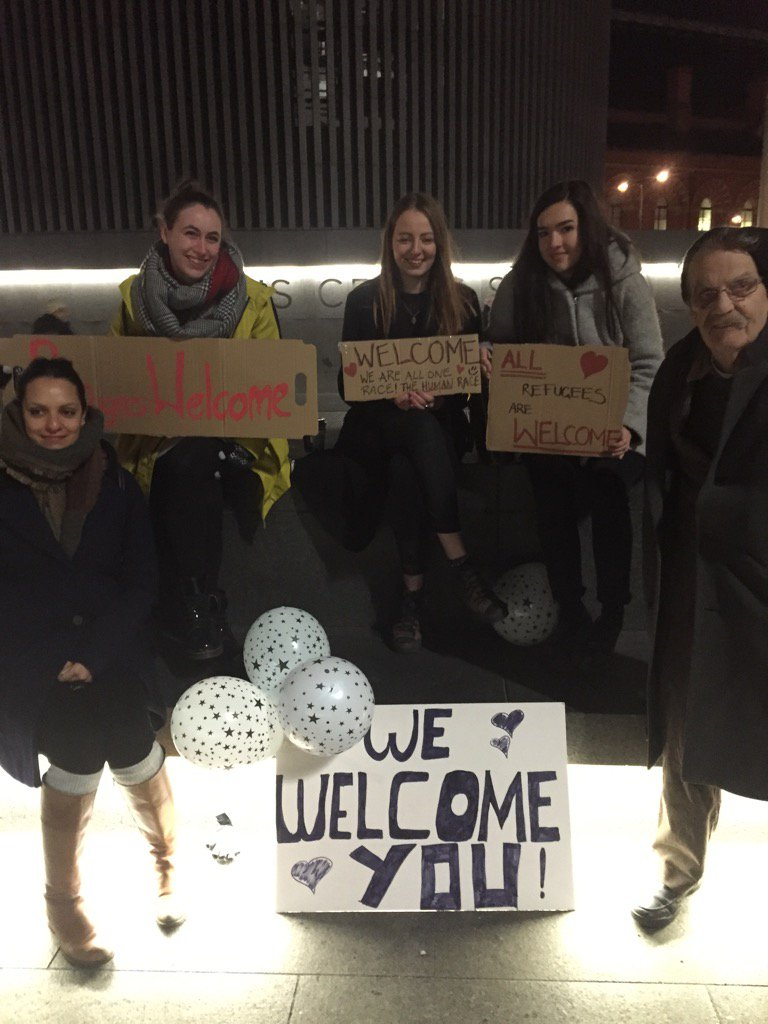 Supporters arrive in Kings Cross, London, England to welcome four Syrian refugees arriving from Calais