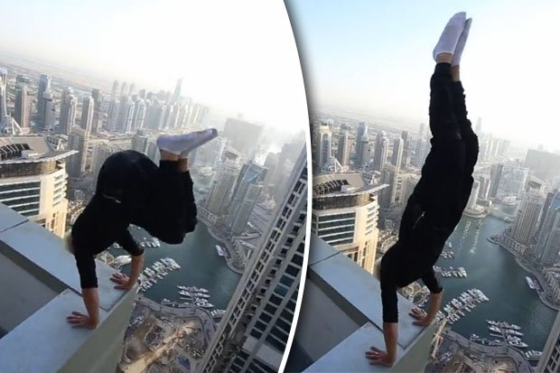 INSANE CLIP Man Risks Death Performing Handstand On Skyscraper Roof Ledge