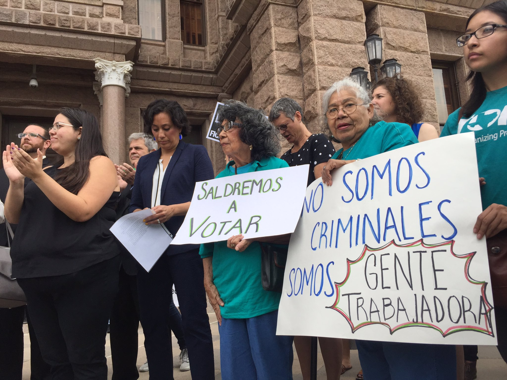 """Protesters at rally w signs that read """"We will vote."""" """"We are not criminals, we are working people."""" #sb4 #txlege https://t.co/Vab2qXiz4Y"""