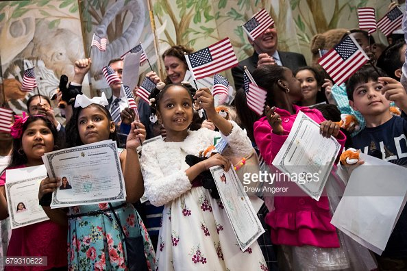 Children become U.S. citizens during a ceremony at the #BronxZoo https://t.co/hHGS9PsNDM #NewsUnfiltered :camera:: @drewangerer https://t.co/UYpWkFx8vw