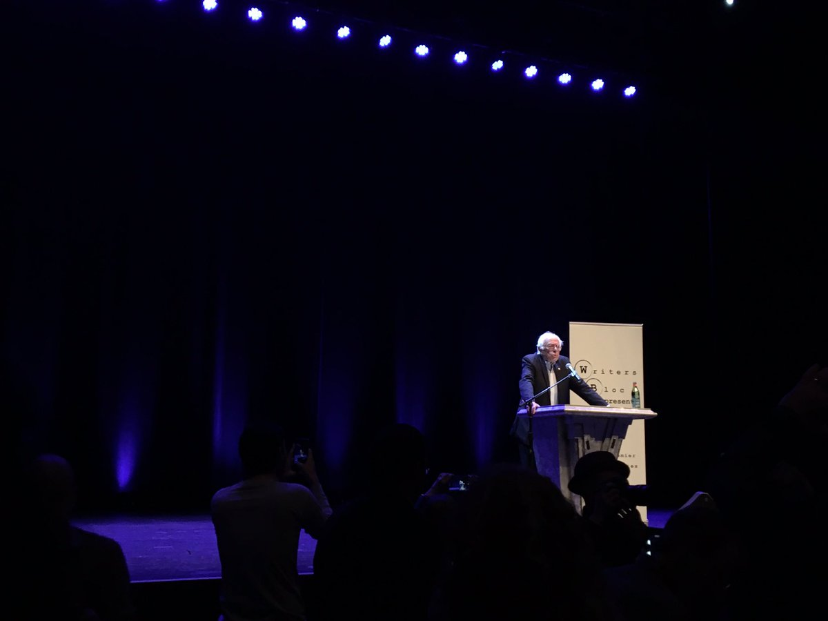 """Vermont Sen. Bernie Sanders speaks to a sold-out crowd in Beverly Hills on Sunday to promote his book """"Our Revolution."""" (Christine Mai-Duc / Los Angeles Times)"""