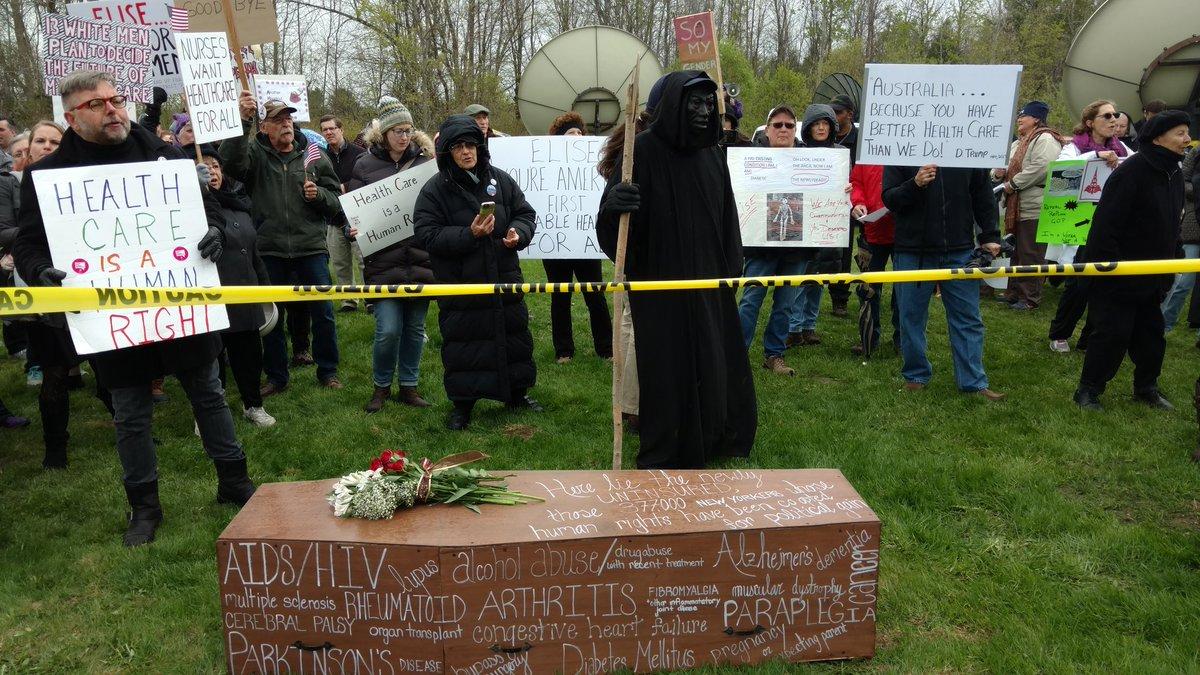 Stefanik protesters bring coffin and dea...