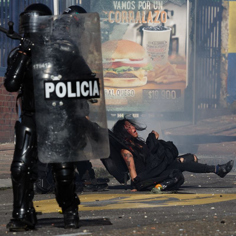 Photographers catched the moment where Colombian Police attacked a woman in teachers protest in Bogotá, Colombia. The woman was hit in the head by a gas bullet shot by the police, then she was surrounded and beaten brutally.
