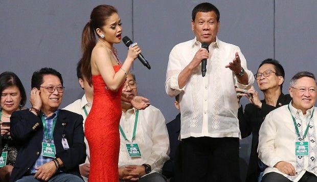 "In Hong Kong, Rodrigo Duterte ""sang a surprise duet with singer Kristine Gonzaga Demeterio"""