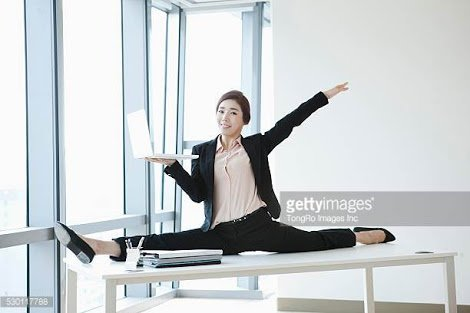 """Accidentally discovered a weird new genre of stock photo, """"businesswoman doing the splits"""""""