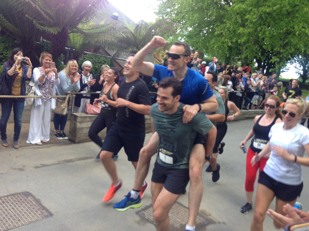 #HenryCavill crosses the finish line of the #DurrelChallenge in style giving a piggyback! https://t.co/trljwT6eMQ