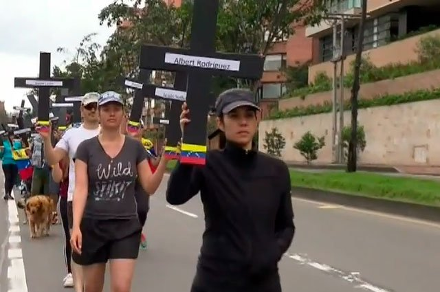 With crosses representing dead protesters, Venezuelan mothers marched in Bogota