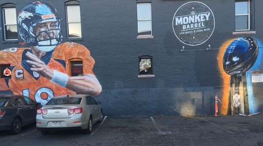 In 2014 a Manning mural went up in Denver. Today it got a Vince Lombardi Trophy Broncos