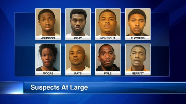 8 gang members charged in counterfeit ticket scheme still at large, police say