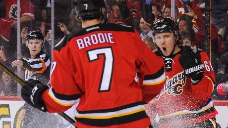 Undermanned Flames hold off banged-up Maple Leafs