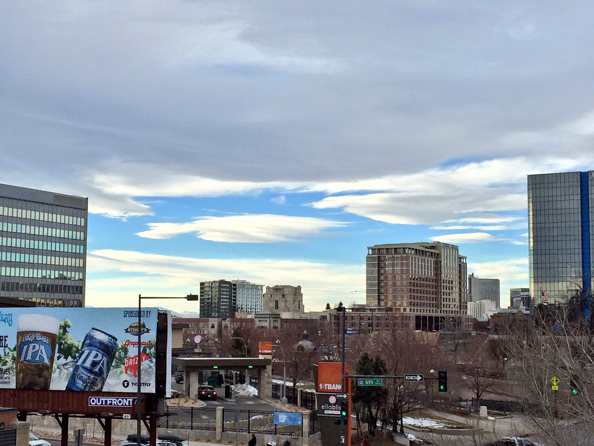 Cool view from wx deck of lenticular clouds getting sheared out over Denver.