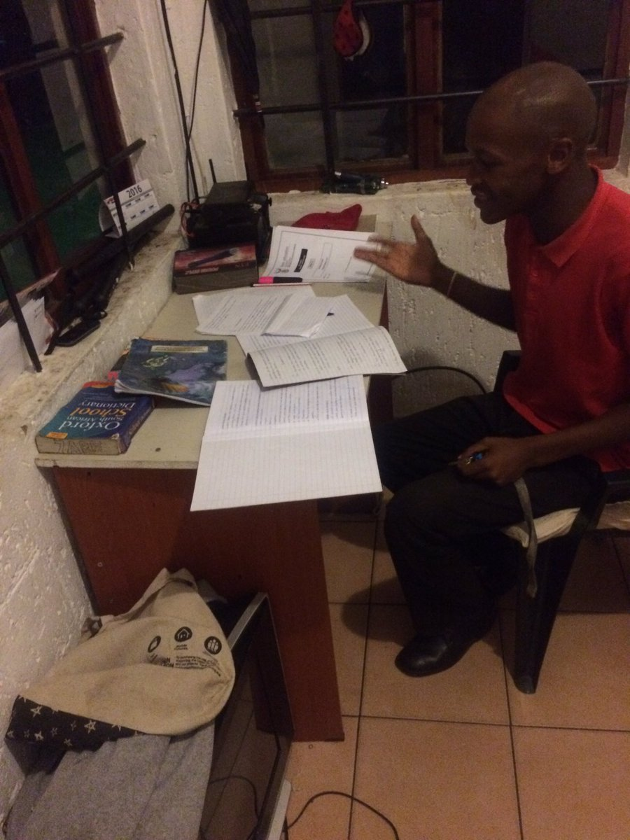 My security guard studying and working at the same time. His not satisfied with just a matric certificate! Champ