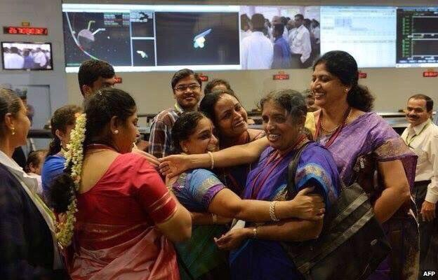 Scientists from #India celebrate putting a satellite into Mars orbit. #WomenInSTEM
