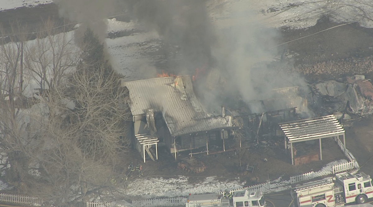 Larkspur fire still battling this fully involved house fire. Fire fighters using water from a nearby pond
