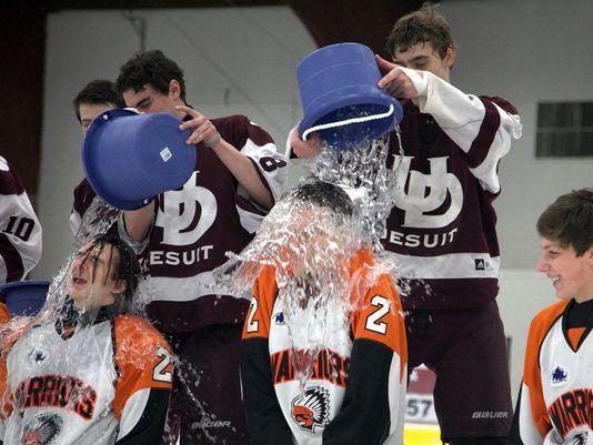 @nealrubin_dn: An ice bucket challenge at an ice rink