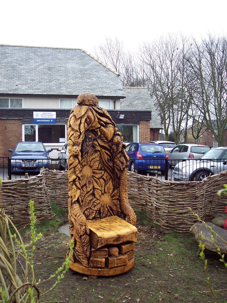 Wall murals and chainsaw carvings artwork by brian flowers a