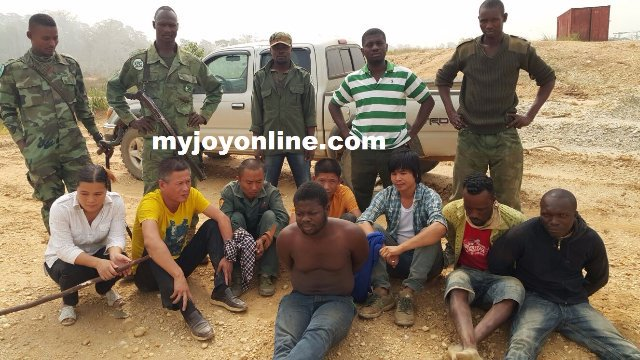 The Ghanaian suspects are handcuffed, the Chinese suspects…